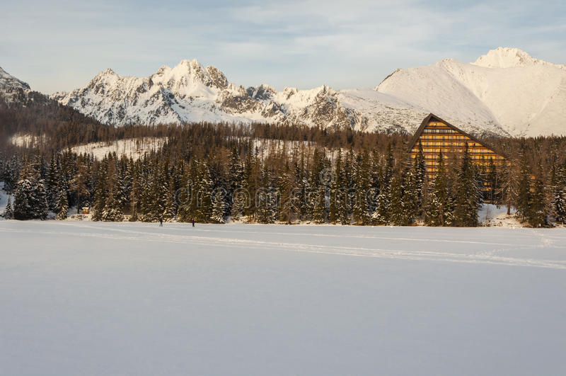 Characteristic Hotel in the High Tatras over the frozen Lake Strbske pleso and beautiful mountain view. royalty free stock photo