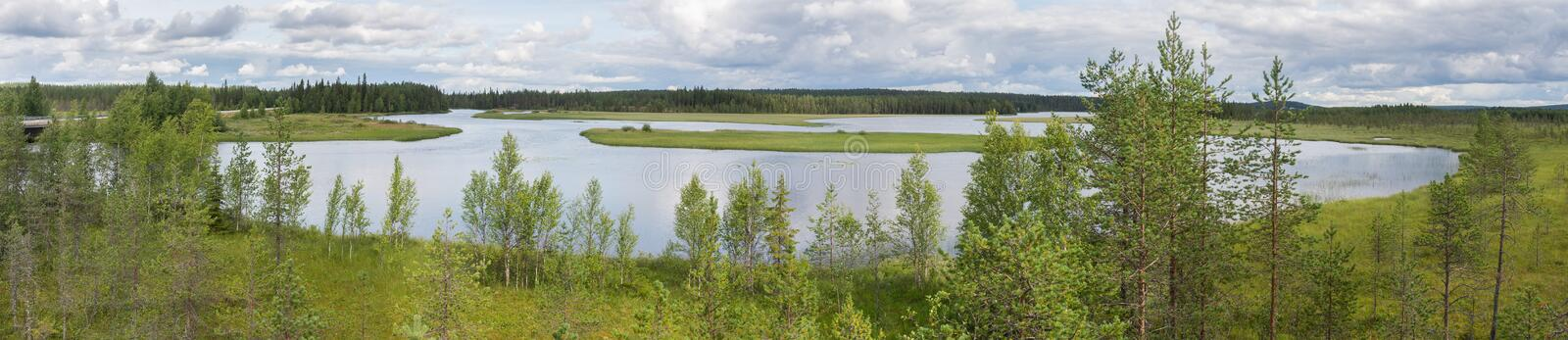 Characteristic landscape of the tundra, lake and vegetation, Fin. Typical landscape of the tundra, lake and vegetation, Finland royalty free stock photo