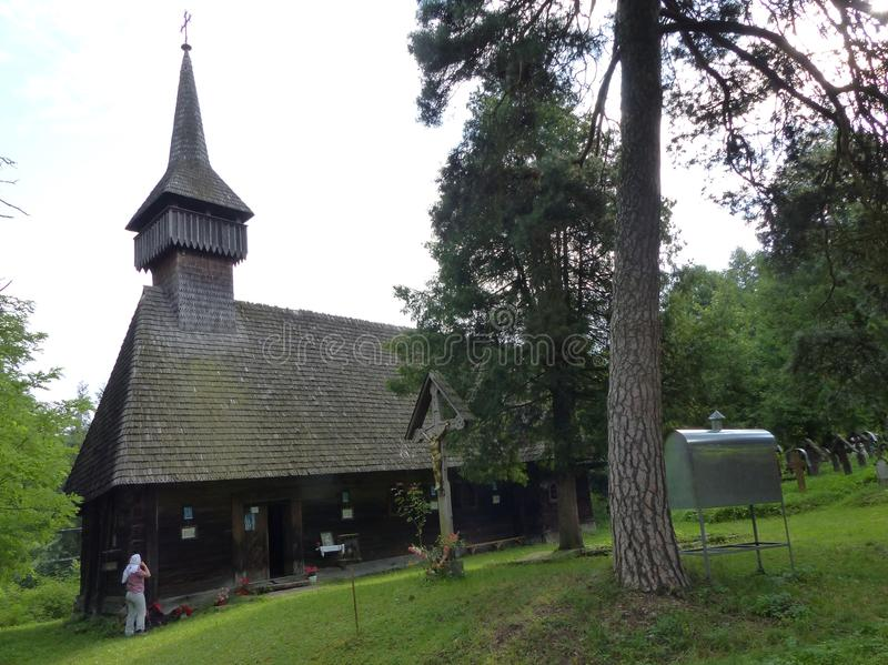 Characteristic long church of wood of the region of the Maramuresh in Romania stock photography