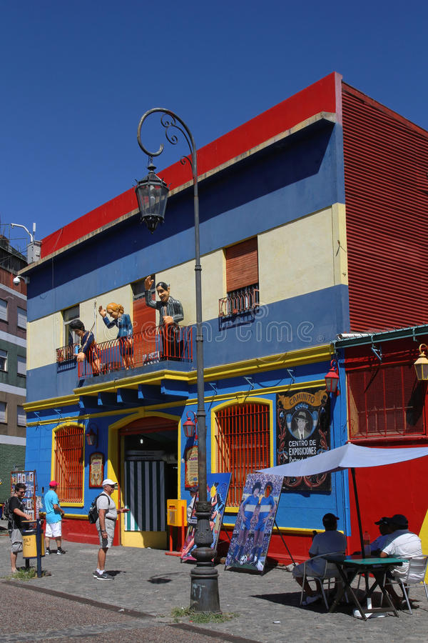 Characters at the balcony in La Boca. BUENOS AIRES, ARGENTINA, December 22, 2013 : Streets of La Boca. This district is a popular destination, with its colourful stock image