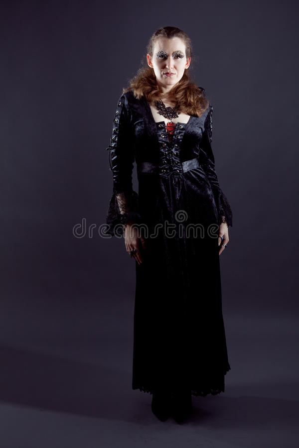 Young women in black long dress stock photography