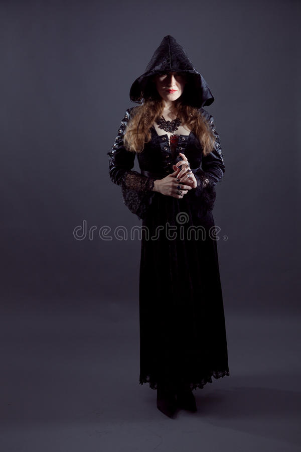 Young women in black long dress royalty free stock photo
