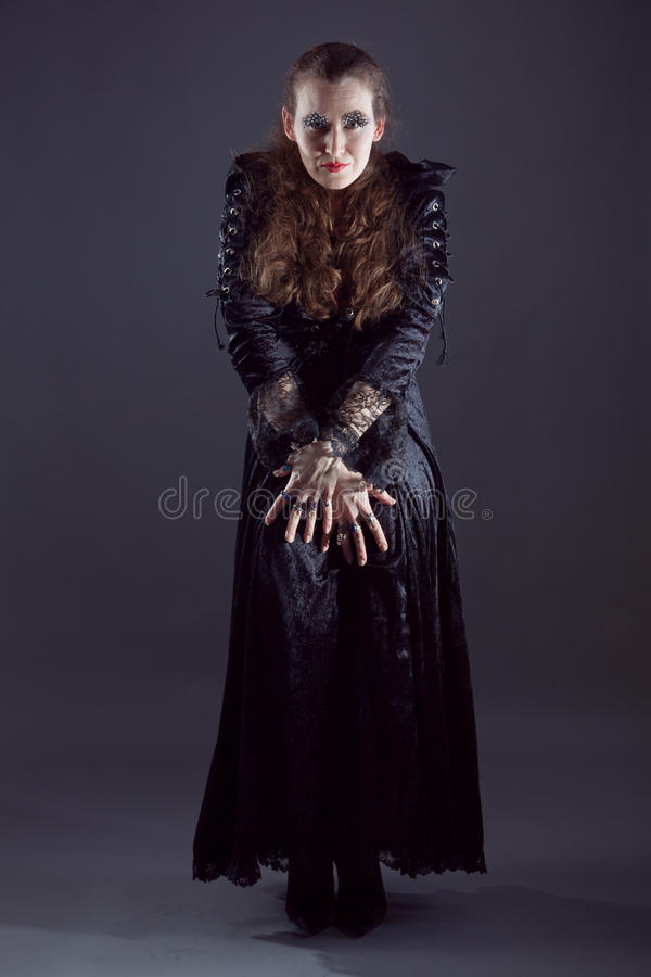 Young women in black long dress royalty free stock images