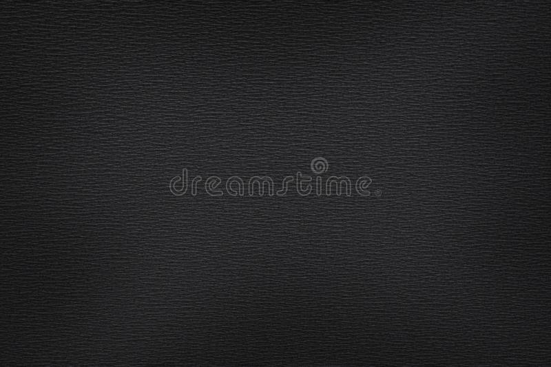 Charcoal black abstract textured background. Charcoal black abstract texture and background with light center. Close up of textured surface royalty free stock photography