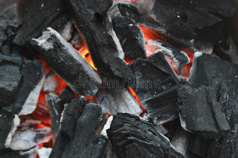 Charcoal burning on a charcoal stove stock image