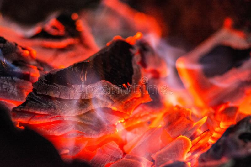 Charcoal. Burning horn. Burning coals in the grill royalty free stock photo