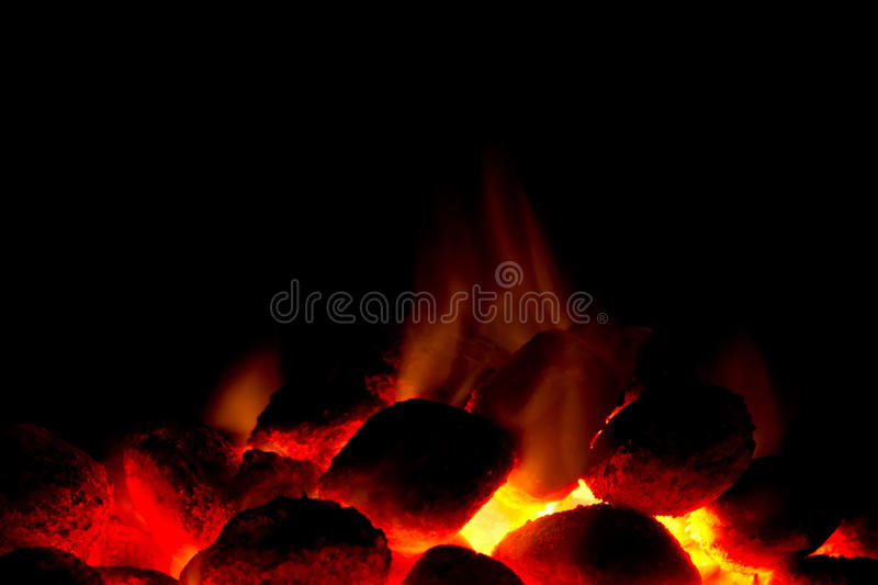 Charcoal fire for barbecue. Horizontal image of hot charcoal fire ready for barbecue with black copy-space stock image