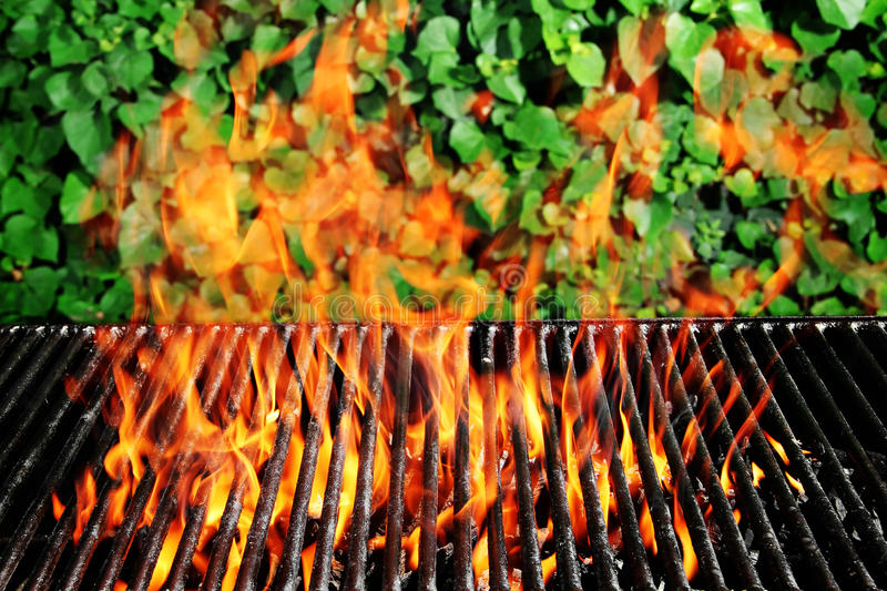 Charcoal fire grill. Stock image of charcoal fire grill over ivy background with live flames royalty free stock photography