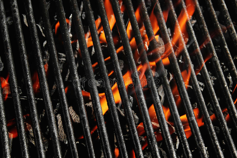 Charcoal fire grill. Stock image of charcoal fire grill, close up with live flames royalty free stock images