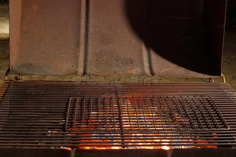 Charcoal fire grill, close up with live flames. royalty free stock image