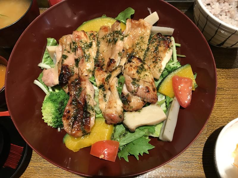 Charcoal grilled chicken. Charcoal grilled chicken served with salad royalty free stock photos