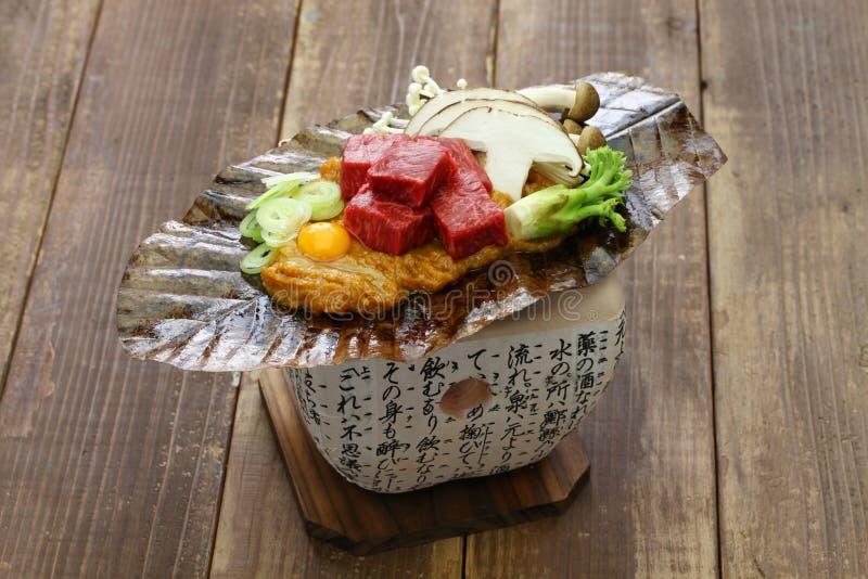 Charcoal grilled Hida beef on Hoba miso, Japanese local dish. Charcoal grilled Hida beef on Hoba miso, Japanese Takayama local dish stock photos