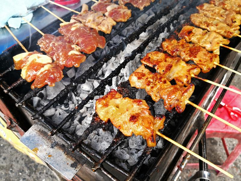 Charcoal grilled pork skewer on grill. Street food of Thailand stock image
