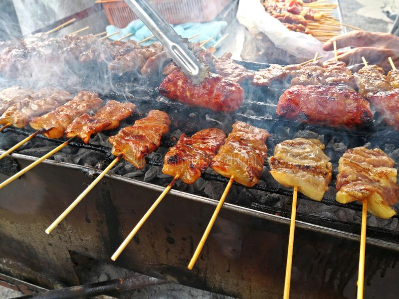 Charcoal grilled pork skewer on grill. Street food of Thailand royalty free stock photo