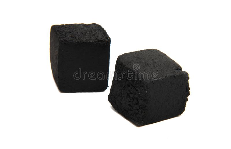 Charcoal for hookah isolated. On white background stock photos