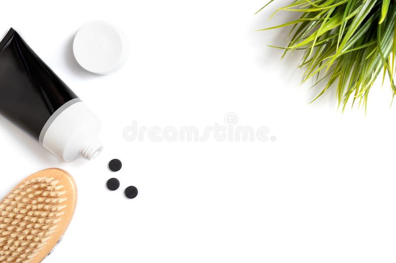 Charcoal scrub, cleanser or mask for natural organic cleansing and skin care on white background with copy space royalty free stock photo