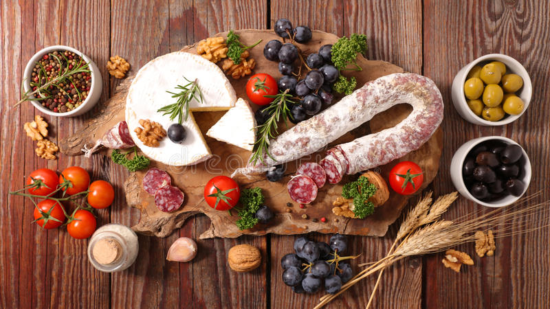 Charcuterie and cheeses royalty free stock image