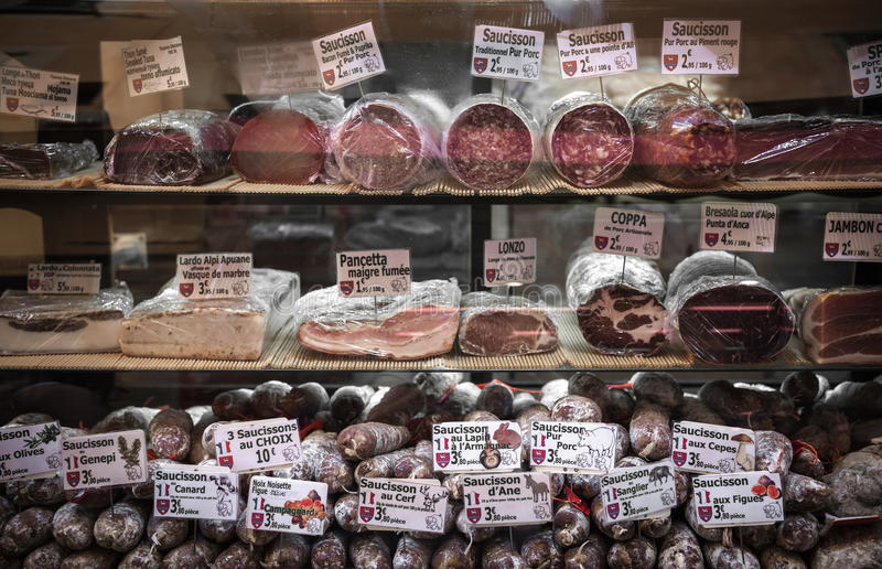 Charcuterie on display in butcher shop in old Nice, France. stock images