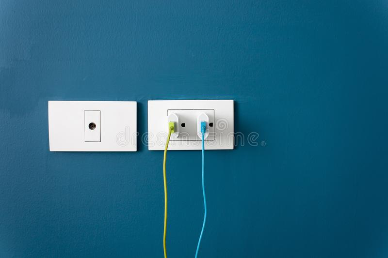 Charge the battery for the smartphone on wall stock photos