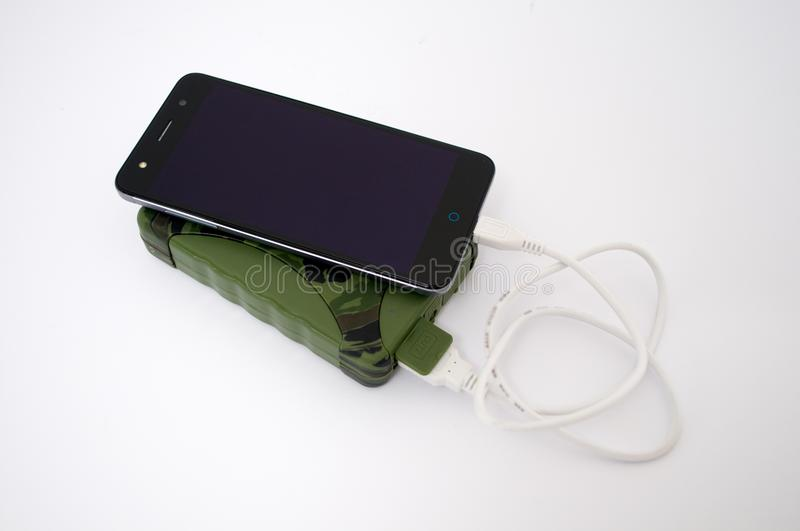 Charge your phone with the help of the military power bank packs stock images