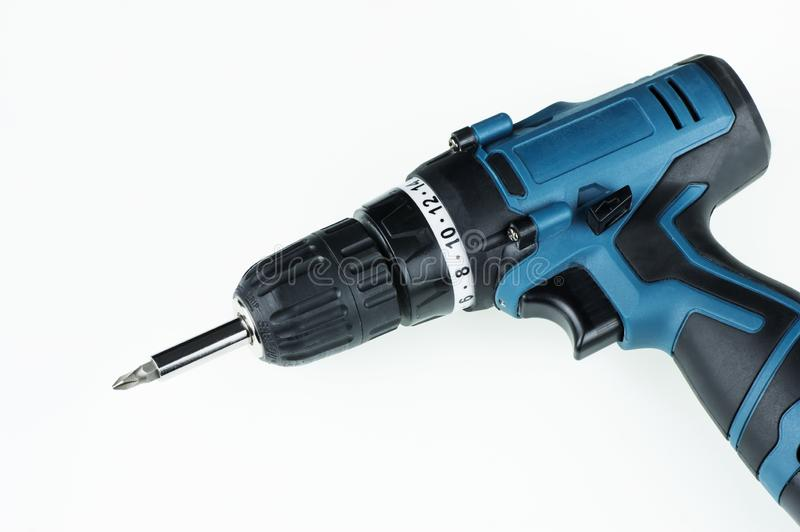 Charged blue drill screwdriver on white background stock photo