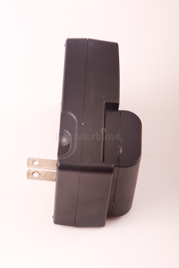 Chargeur de batterie d'appareil-photo images libres de droits