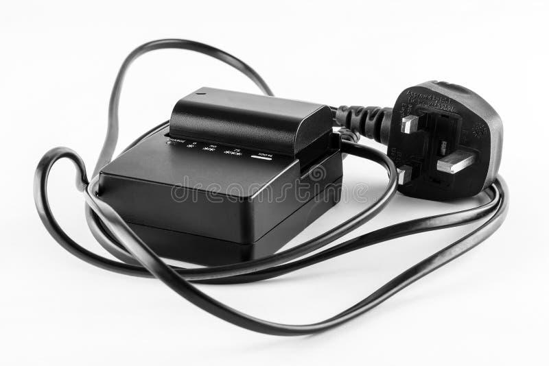 Chargeur de batterie d'appareil-photo photographie stock libre de droits