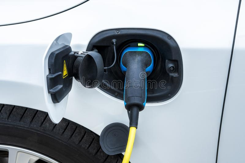 Charging an electric car battery stock image