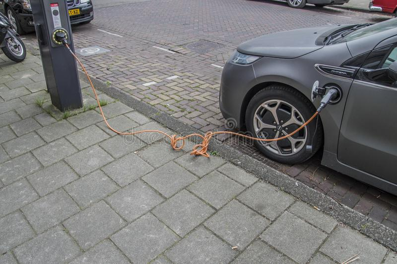 Charging An Electric Car. At Amsterdam The Netherlands 2018 stock photos