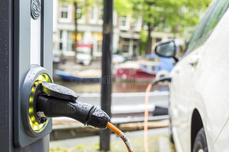 Charging an electric car. stock image