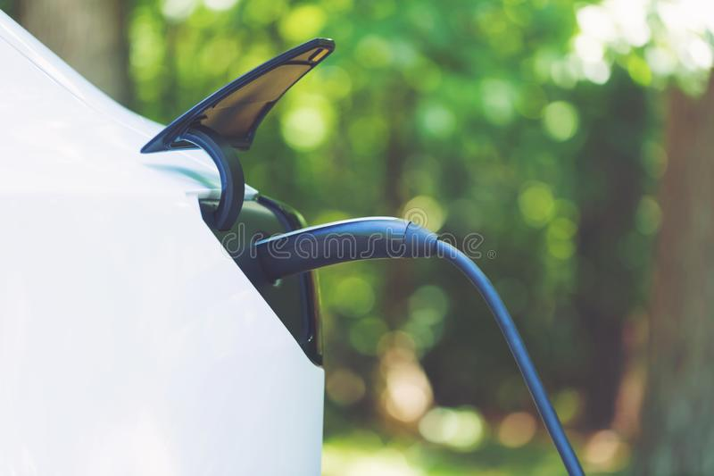 Charging an electric vehicle royalty free stock photo