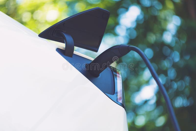 Charging an electric vehicle stock images