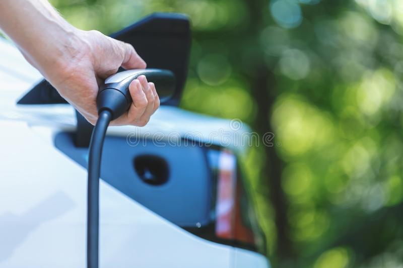 Charging an electric vehicle stock image