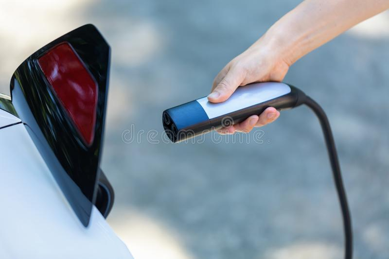 Charging an electric vehicle royalty free stock photos