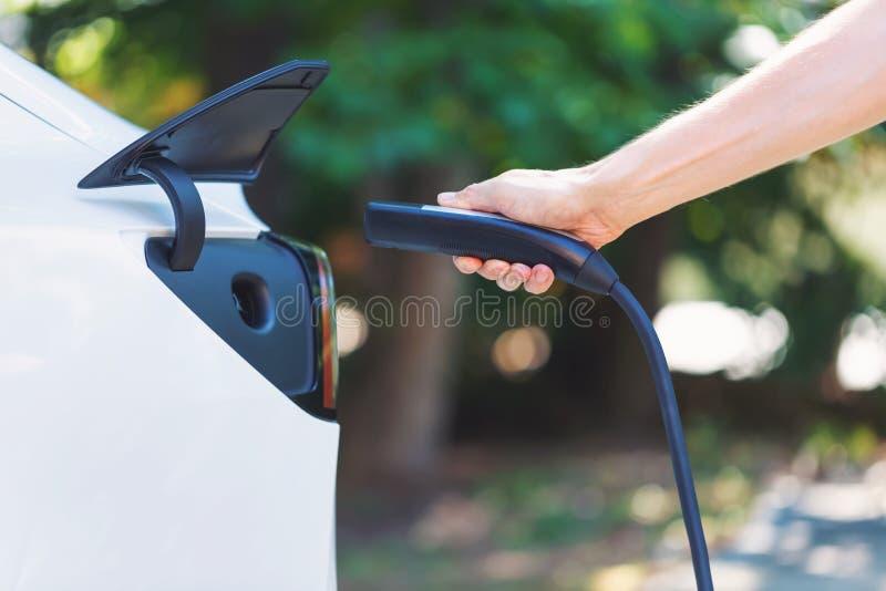 Charging an electric vehicle stock photos