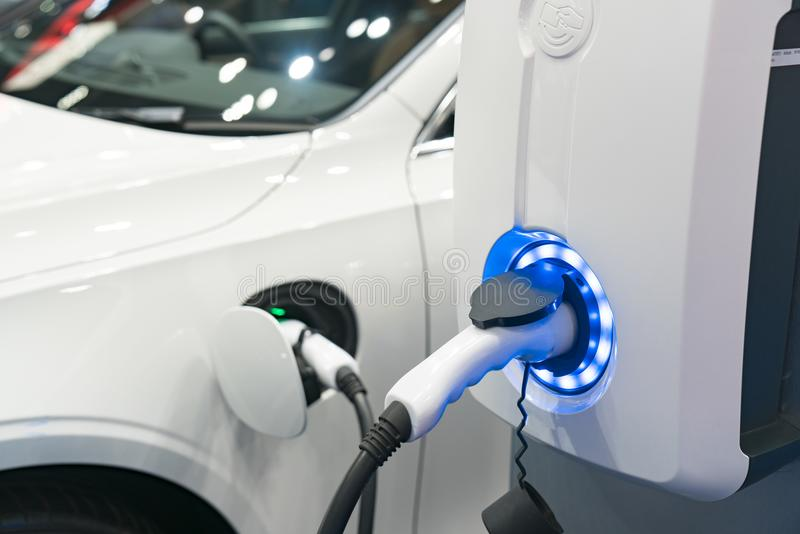 Charging modern electric car on the street which are the future stock photo