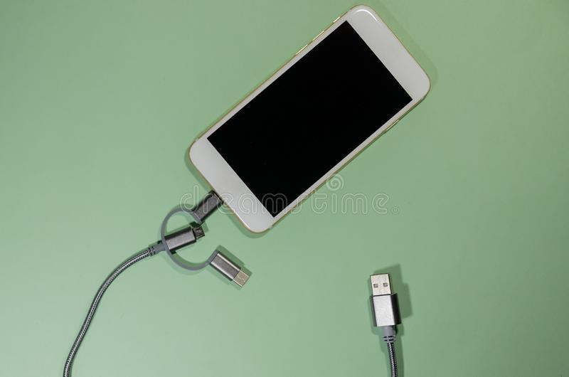 A charging phone with cable royalty free stock images