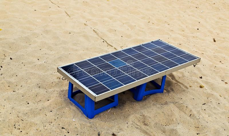 Charging solar panels battery Sandy Beach, mobile device royalty free stock photography