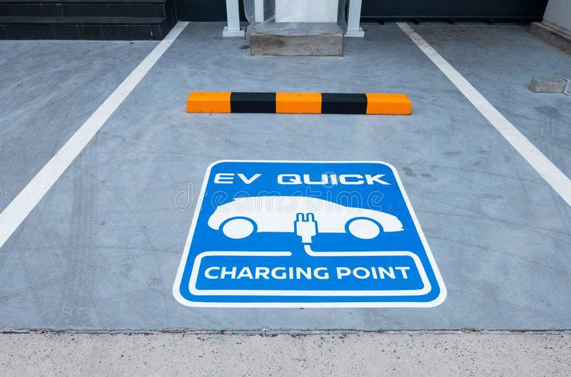 Charging station for electric vehicle.outdoor car parking . blue sign EV quick charging point stock photography