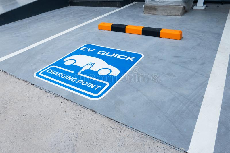 Charging station for electric vehicle.outdoor car parking . blue sign EV quick charging point stock image