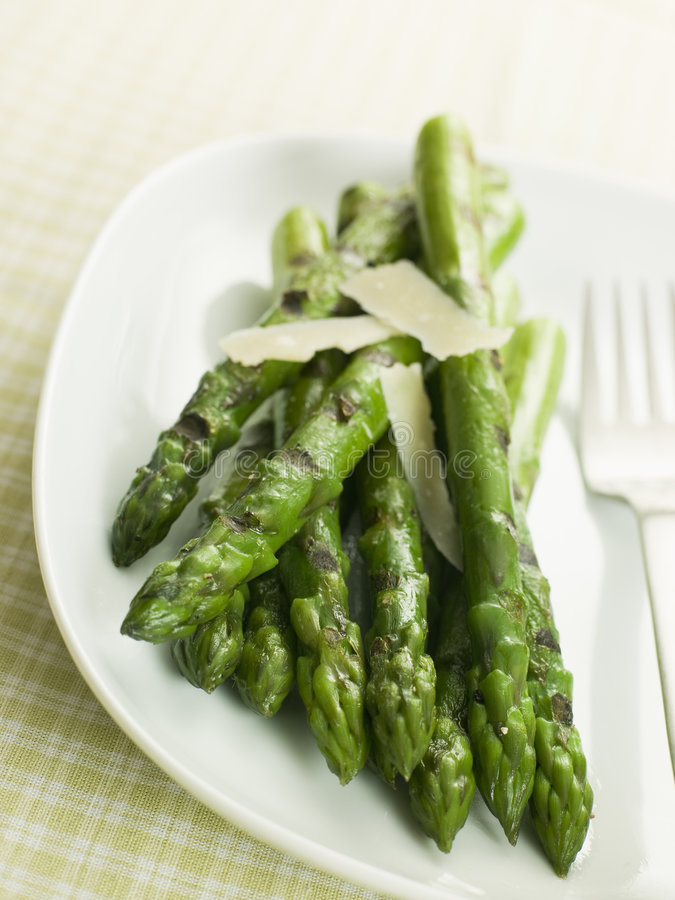 Chargrilled Asparagus Spears with Parmesan Cheese. Plate of Chargrilled Asparagus Spears with Parmesan Cheese Shaves stock photography