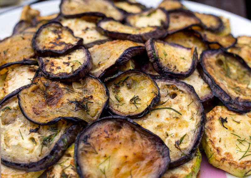 Chargrilled eggplants with fresh herbs.  stock photo