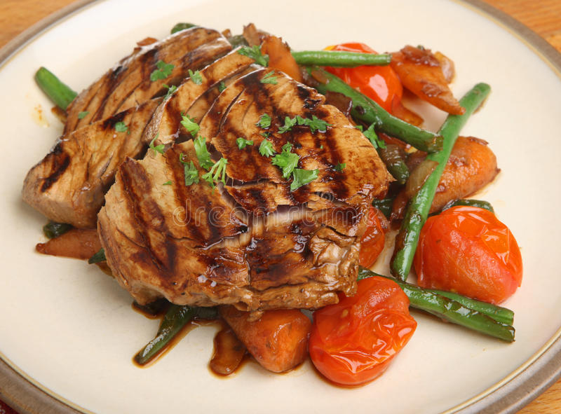 Chargrilled Tuna Fish Steak with Vegetables. Marinated & chargrilled tuna fish steak with stir-fried vegetables royalty free stock photography