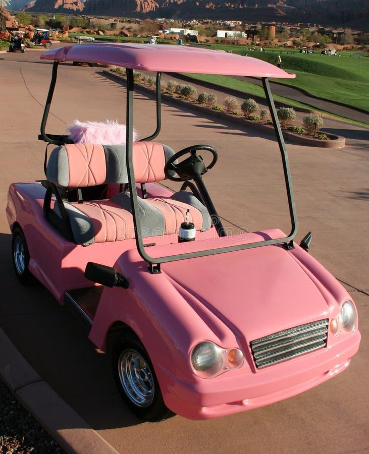 Chariot de golf de dames roses photographie stock