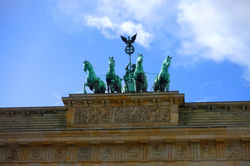 Chariot and Horses on Top of Brandenburg Gate in Berlin. Close-up of the bronze chariot and four houses that sit on top of the Brandenburg Gate in Berlin royalty free stock image
