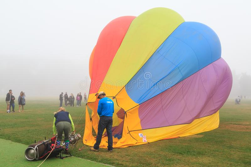 A small single-seat hot air balloon just after landing. A `Chariot` hot air balloon, with a single seat for the pilot, on the ground. A large cylinder of royalty free stock images