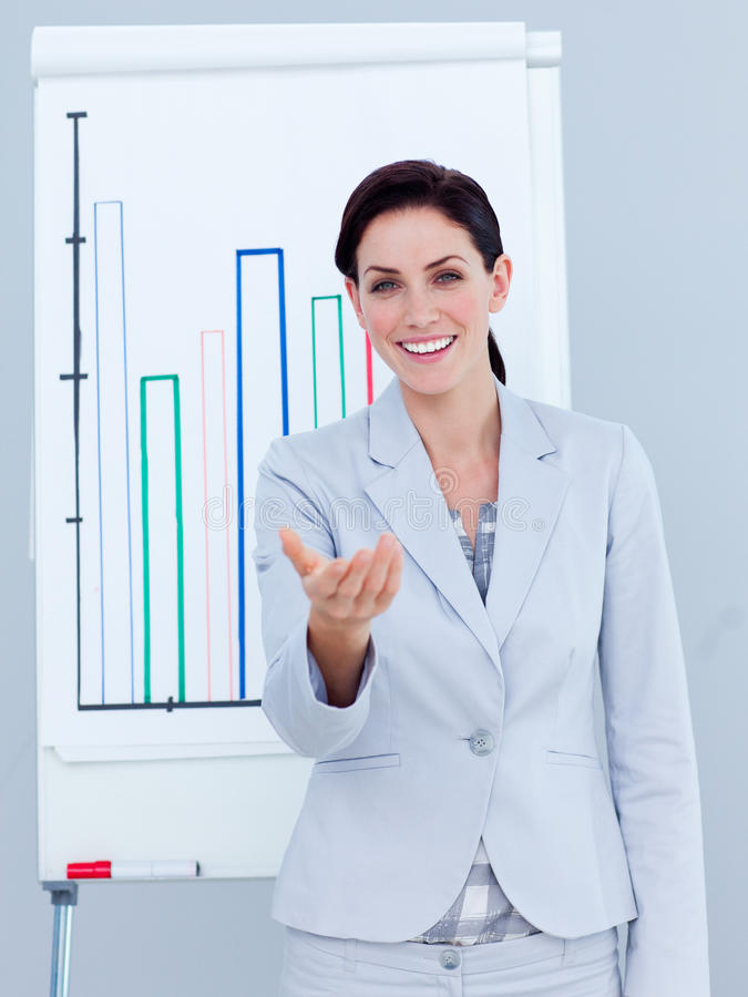 Charismatic businesswoman giving a presentation royalty free stock photo