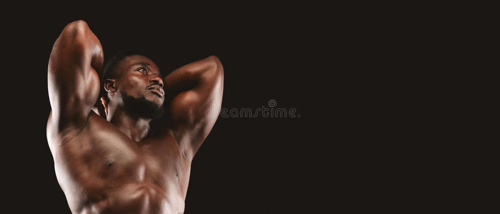 Charismatic fitness model with his hands behind head stock images