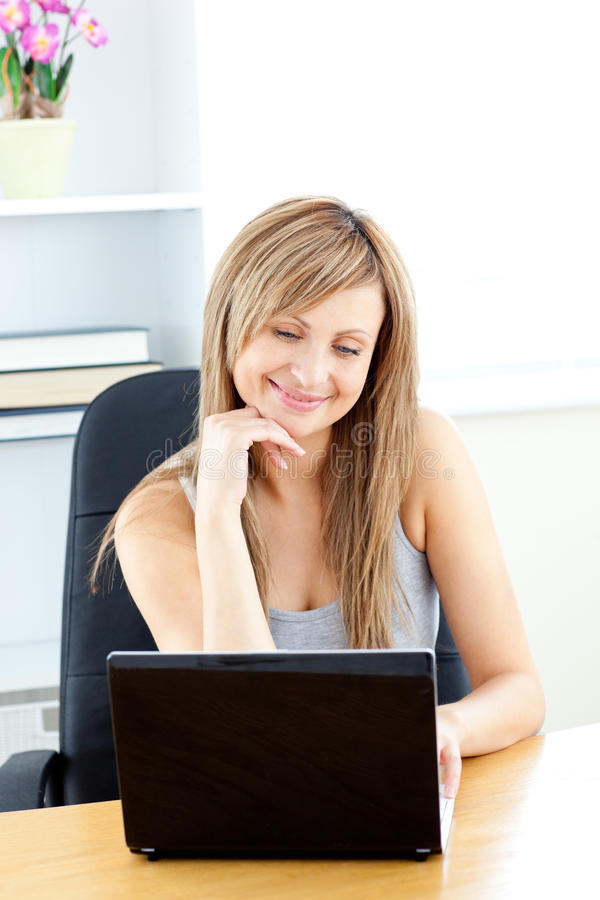 Download Charismatic Young Businesswoman Using Her Laptop Stock Photo - Image: 15615842