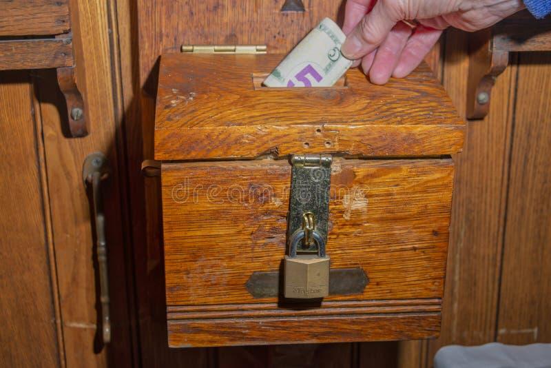 Charity box at a church royalty free stock photography